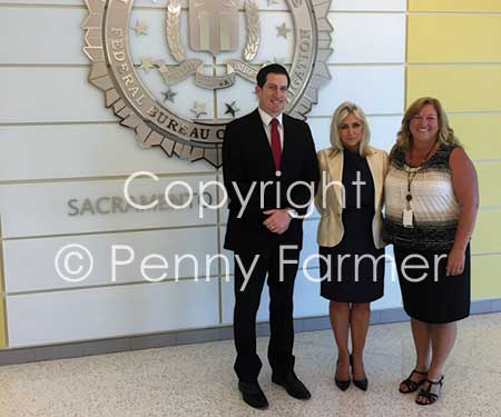 With FBI Special Agent David Sesma and Victim Specialist Carol Watson (right).